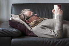 Lying Man reading book Royalty Free Stock Images