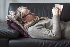 Lying Man reading book Stock Photos