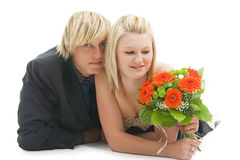 Lying man and woman with flower. Royalty Free Stock Images