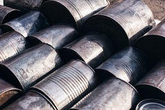 Lying metals cans. Lying gray metals cans outdoors on asphalt Stock Photo