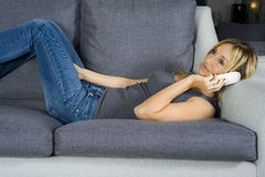 Lying with mobile phone Stock Photography