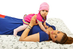 Lying mother with her baby Stock Photo