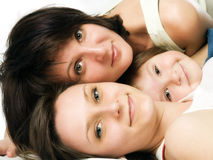 Lying mother and two daughters Royalty Free Stock Photos