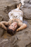 Lying in the mud Royalty Free Stock Image