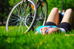 Lying near bicycle Stock Photos