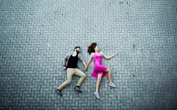 Lying on pavement. Image of affectionate dates lying on pavement royalty free stock images