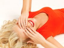 Lying pensive beautiful woman with closed eyes Stock Photos
