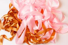 Lying pink and brown ribbons, close-up view from above. Randomly lying pink and brown ribbons, close-up view from above Stock Photos