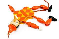 Lying Pinocchio mechanical toy. Isolated on white white Royalty Free Stock Photos