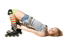 Lying pretty girl in roller skates royalty free stock photo