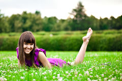 Lying pretty smiling girl Royalty Free Stock Photos
