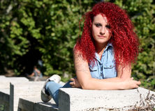 Lying red curly hair styled teen Royalty Free Stock Photography