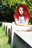Lying red curly hair styled teen Stock Photography