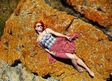 Lying redhead girl relaxing royalty free stock photo