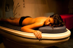 Lying relaxed woman during spa treatment. Royalty Free Stock Image