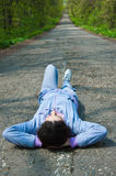 Lying on the road Royalty Free Stock Images
