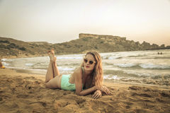 Lying on the sand Royalty Free Stock Images