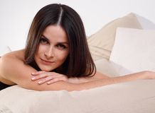 Lying sexy brunette young woman Stock Images