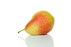 Lying single spotty yellow-red pear. Isolated on the white background Stock Photography