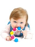 Lying smiling child with a toy Stock Images