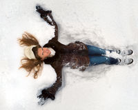 Lying in the snow Stock Photography