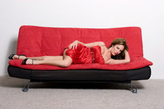 Lying on sofa Royalty Free Stock Images