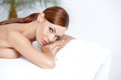 Lying on spa bed Stock Image