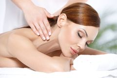 Lying on spa bed Stock Photos