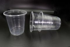 Lying and standing plastic cups  on black background royalty free stock photos