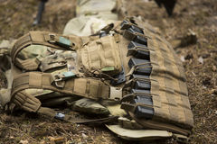 Lying tactical vest on the ground. With holders royalty free stock image