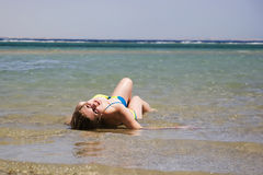 Lying in the water Stock Image