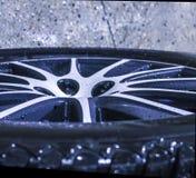 Lying wet car wheel stock images