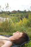 The lying woman. (on green grass Royalty Free Stock Photos