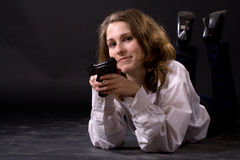 Lying woman with gun Royalty Free Stock Photography