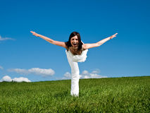 Lying woman on the meadow. Happy woman on a meadow does the plane Stock Photos
