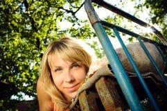 Lying woman outdoors Stock Photos