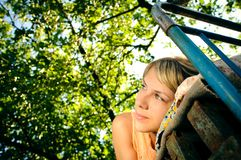Lying woman outdoors Royalty Free Stock Images