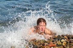 Lying woman in the sea Royalty Free Stock Photos