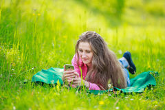 Lying woman with phone Royalty Free Stock Photo
