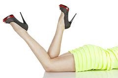 Lying woman in shoes Royalty Free Stock Images