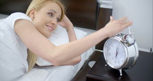 Lying Woman Turning Off an Alarm Clock stock video