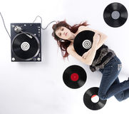 Lying Woman with Vinyl Turnaround and Records Royalty Free Stock Photo