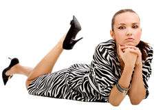 Lying woman in zebra dress Stock Photo