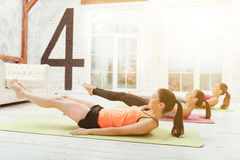 Lying women doing gymnastics at gym Stock Photo