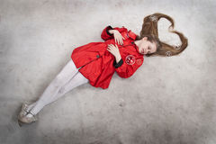 Lying young girl with long blond hair Royalty Free Stock Photo