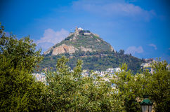 Lykavitos. Mount Lycabettus, also known as Lycabettos, Lykabettos or Lykavittos & x28;Greek: Λυκαβηττός& x29;, is a Cretaceous limestone hill in Athens Royalty Free Stock Image