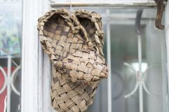 Lykovye, natural sandals weigh for sale on the window frame. Vladimir. Russia. royalty free stock photos