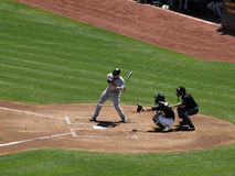Lyle Overbay looks at incoming pitch crosses plate Royalty Free Stock Photos