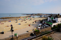 Lyme Regis beach and harbour Dorset uk coast in the late summer sunshine Stock Image