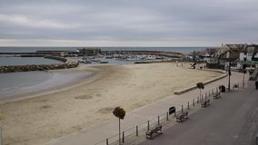 Lyme Regis Dorset England UK beach and harbour stock footage
